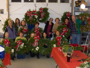 Bedford Garden Club Members displaying holiday wreaths for the community gardens