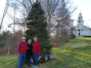 BGC members (from left) John Herper, President Jeanne Popielarz, and Donna Guibord gather in front of the memorial tree that honors those serving in the armed forces
